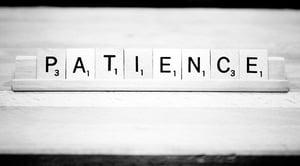 Scrabble tiles spelling out patience