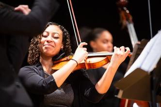 2 women playing violin