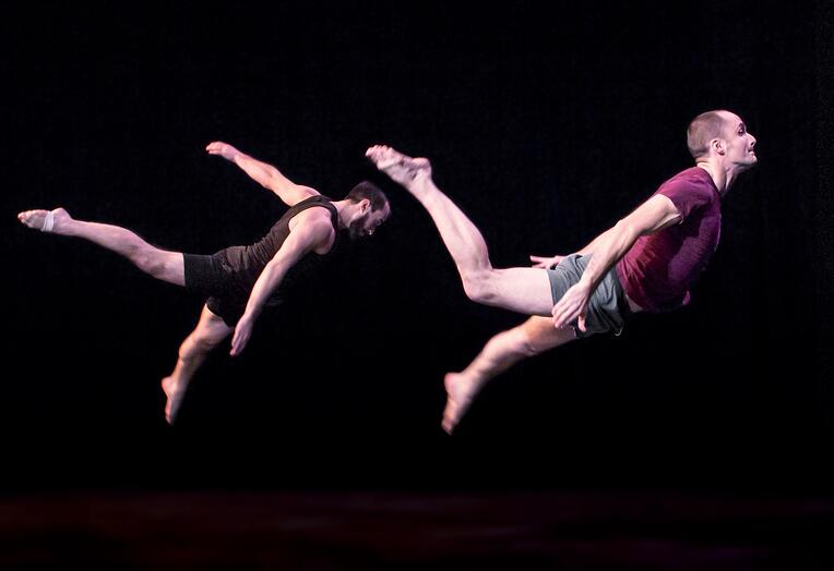 Acrobatic Conundrum dancers in mid-air