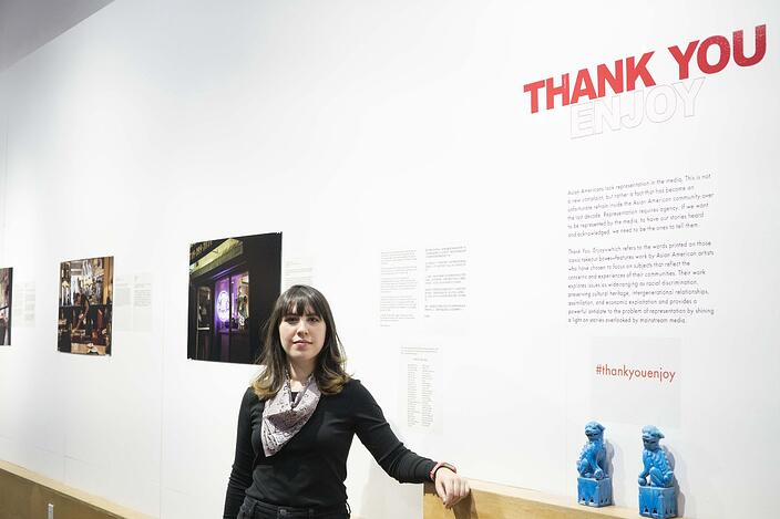 "Photographer and writer Katie Salisbury at the first installation of her exhibition ""Thank You, Enjoy"" in NYC"