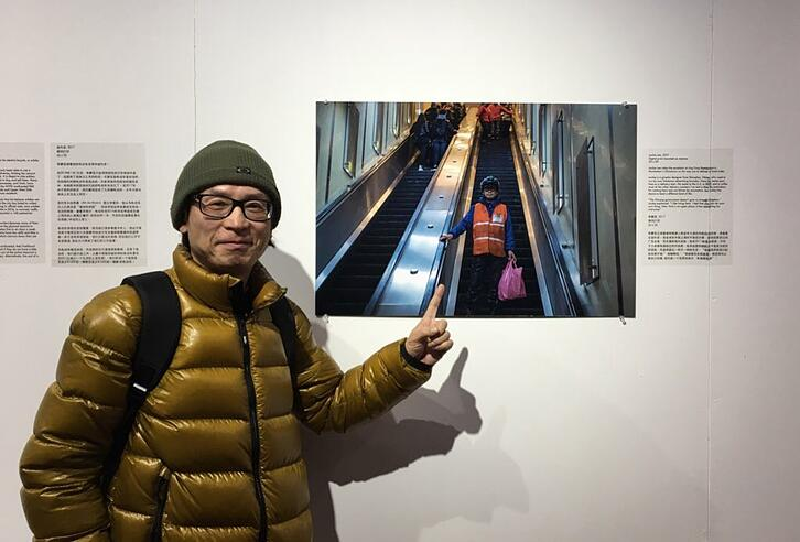 Jackie Lee visiting the exhibition and posing with a photograph taken of him