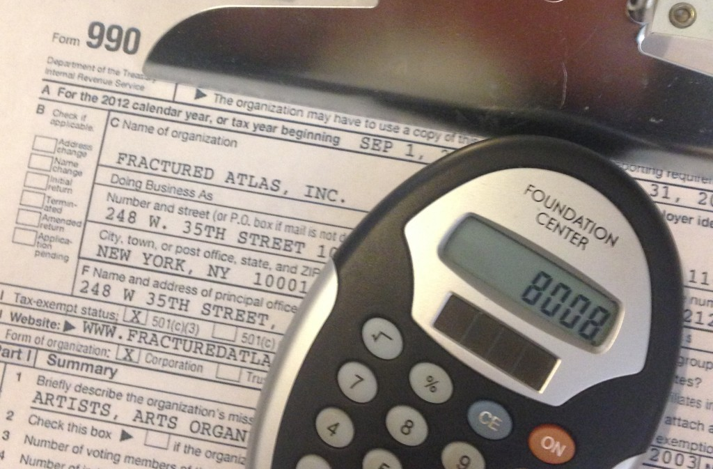 An image of Fractured Atlas's 990 and a calculator from the Foundation Center.