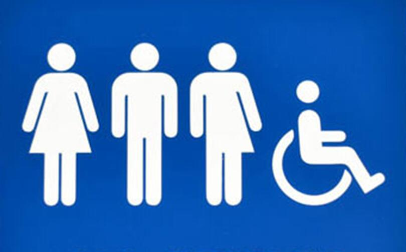 A sign that represents all genders being welcome