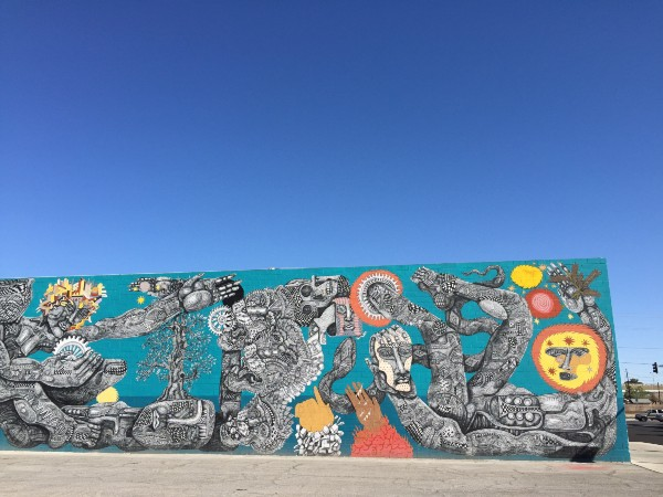 Graffiti wall with blue sky background