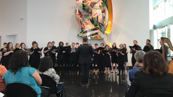 Habitat- Home participants performing for an audience in a gallery