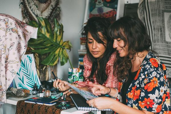 Two women artists collaborating