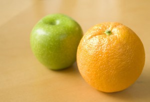 One green apple and one orange