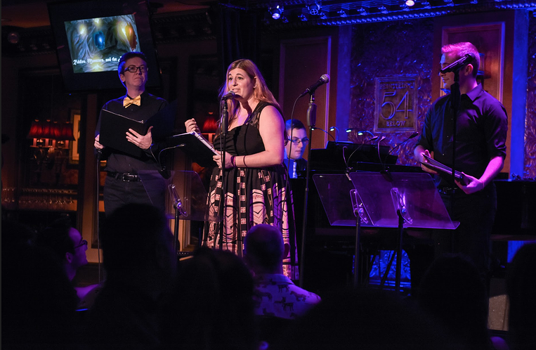 Jamie performs at Feinstein's/54 Below,center stage at the mic with 2 other performers on stage