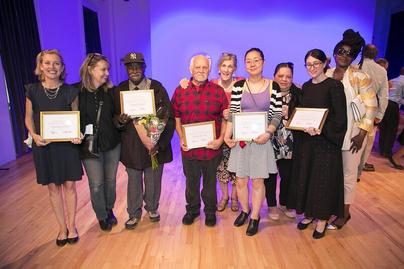"""Community honorees hold their awards at FAB NYC's """"LES Community HeroAwards"""""""