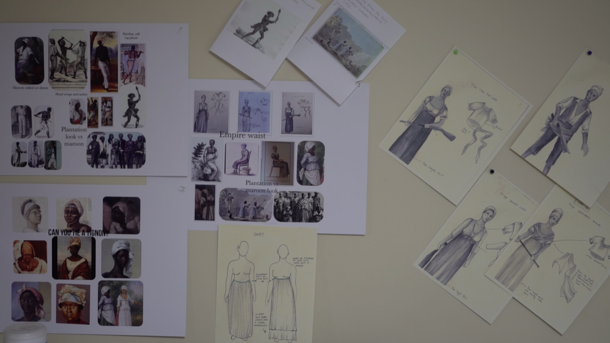 A wall with reference images for antebellum fashion used by the project's costume designers