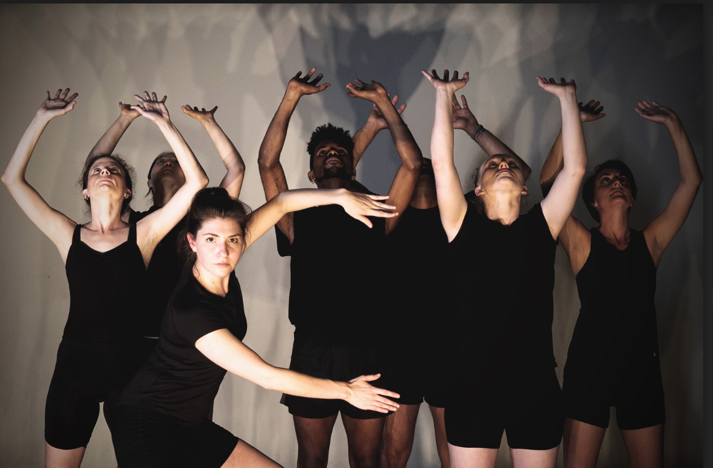 ShaleighDanceWorks performers dancing in unison with hands raised