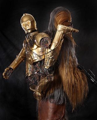 Stars Wars character carrying a broken C3P)