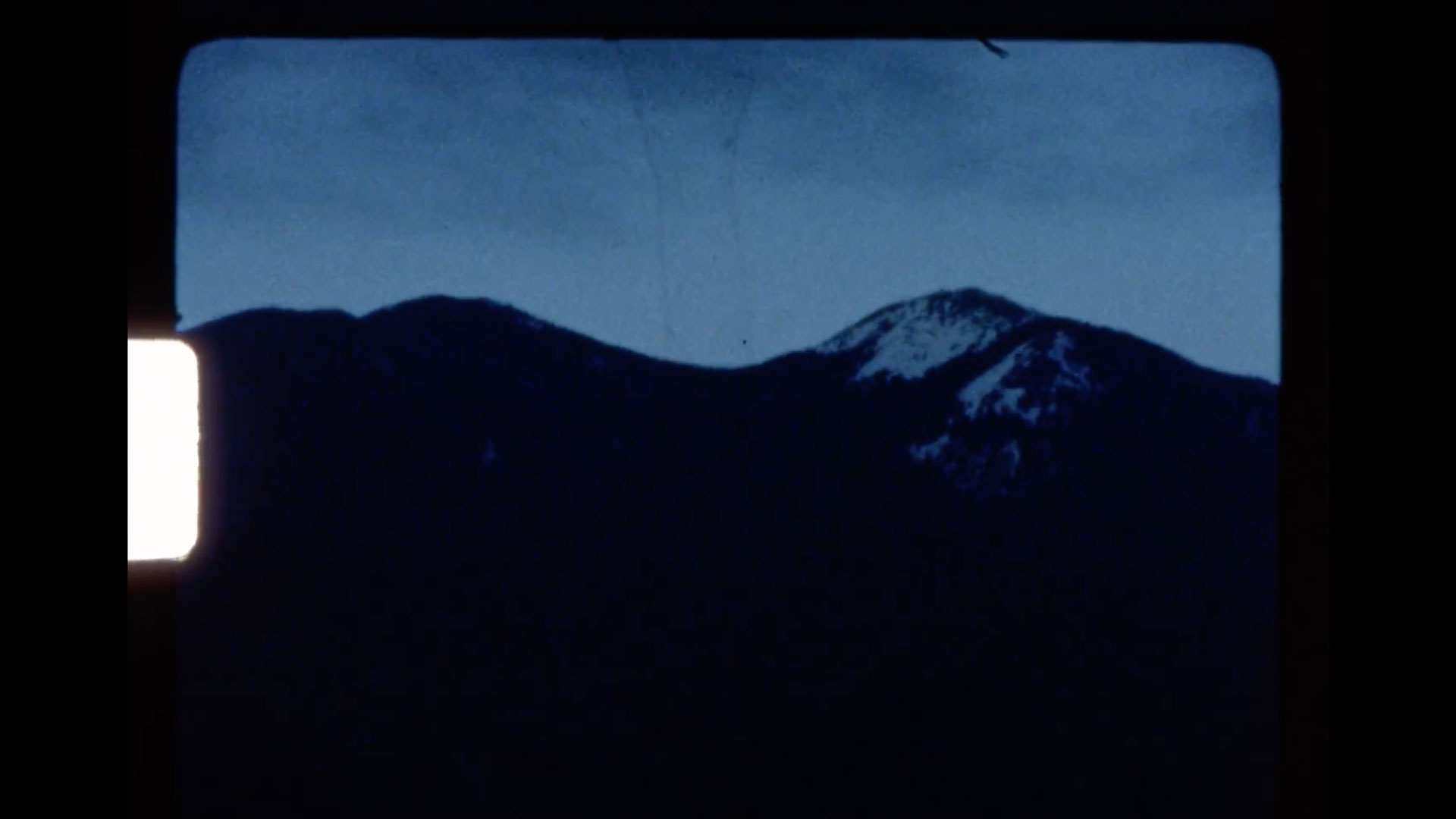 A Super 8 film reel clip of a mountain from Goldilocks