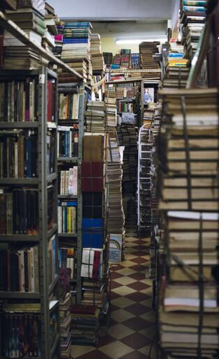 A room filled with books on metal racks.