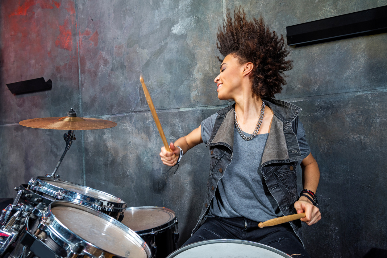 woman playing drums in studio