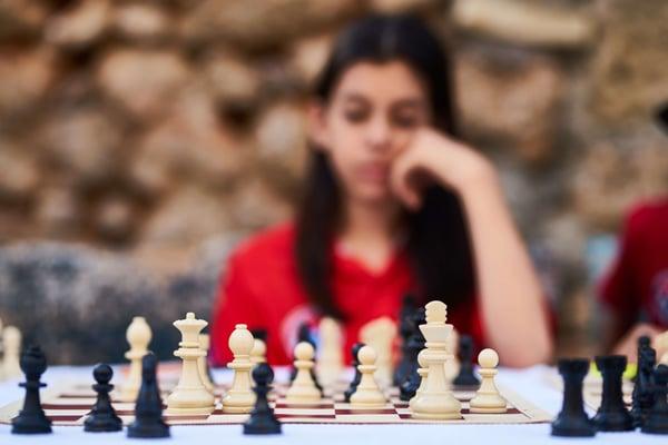 A person faces a chess board.